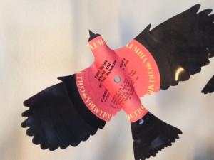 Closeup of bird made from vinyl LP